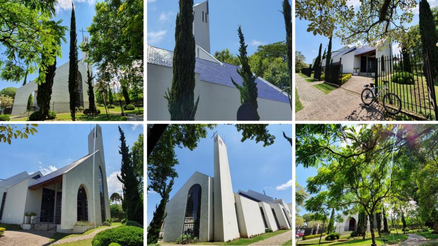 Paróquia Sagrados Corações de Jesus e Maria e a arborizada Praça Santa Filomena.